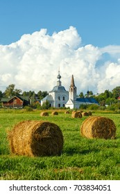 Suzdal, Russia. The Church of St John the Baptist (right) and Church of the Epiphany (left) and field with haystacks.