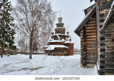 SUZDAL, RUSSIA - From a corner of Resurrection Church on the elegant old Church of the Transfiguration topped with onion domes and Orthodox crosses on grounds of Suzdal's Museum of Wooden Architecture