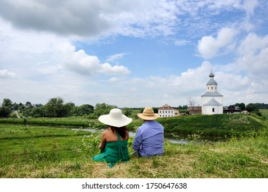 SUZDAL, RUSSIA - A couple enjoying magnificent landscapes of Suzdal from earthen rampart of the local kremlin in summer season.