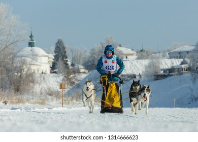 Suzdal, Russia - February 24, 2018: Dog sled racing. One of the participants of the winter race on the snowy track.