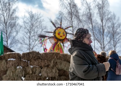 Suzdal, Russia - February 29, 2020: Old Russian woman having fun during the celebration and folk festival, Suzdal. Maslenitsa or Pancake Week is the ancient Slavic Holiday