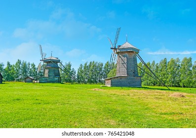 SUZDAL, RUSSIA - JULY 1, 2013: The beauty of Russian nature and historic objects - the log windmills on the meadow in Wooden Architecture museum, on July 1 in Suzdal.
