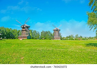 SUZDAL, RUSSIA - JULY 1, 2013: The old preserved wooden windmills on the juicy green meadow in Suzdal museum of wooden architecture, on July 1 in Suzdal.
