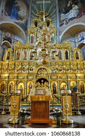SUZDAL, RUSSIA - July 18, 2016 The interior of the renovated single-domed Church of Assumption (Upsenskaya Tserkov) richly decorated with a gilded wood-carved iconostasis (Icon Screen) and frescoes.