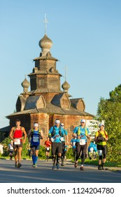 Suzdal, Russia - July 23, 2017: Golden Ring Ultra Trail. Athletes amateurs run a marathon through the streets of the city near the Suzdal landmarks.