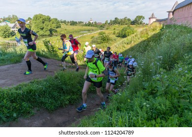 Suzdal, Russia - July 23, 2017: Golden Ring Ultra Trail. Cross-country runners climb the hill.