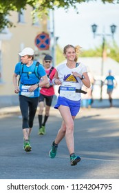 Suzdal, Russia - July 23, 2017: Golden Ring Ultra Trail. Happy girl running in the street.