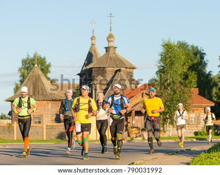 Suzdal, Russia - July 23, 2017: People run through the streets of the city near the landmarks of Suzdal.