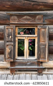 SUZDAL, RUSSIA - July 25, 2013 Traditional decorative carved wood window frame of 19th-century house of wealthy peasant on the grounds of the museum of Wooden Architecture and Peasants' Life in Suzdal