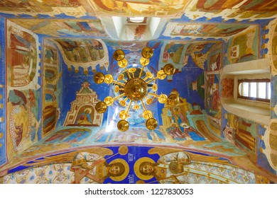 Suzdal, Russia - July 9, 2014: Chandelier and frescoes of the Transfiguration Cathedral in Suzdal