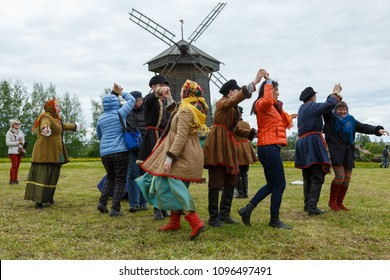 Suzdal, Russia - June 4, 2017: Folk festivities dedicated to the feast of the Holy Trinity in Suzdal. Tourists are taught old Russian dances.