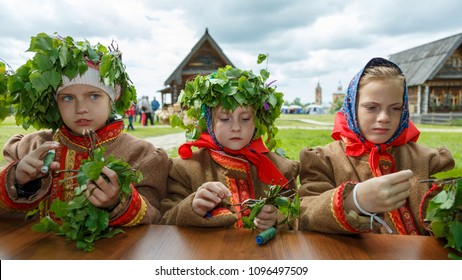 Suzdal, Russia - June 4, 2017: Folk festivities dedicated to the feast of the Holy Trinity in Suzdal. Girls make a doll from birch branches.