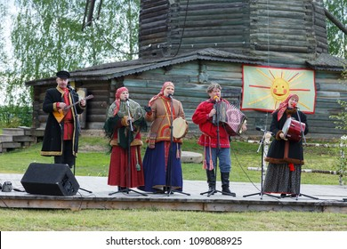 Suzdal, Russia - June 4, 2017: Folk festivities dedicated to the feast of the Holy Trinity in Suzdal. Russian folk ensemble performs.