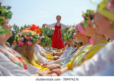 Suzdal, Russia - June 8, 2014: Folk festivities dedicated to the feast of the Holy Trinity in Suzdal. An ancient Russian rite Driving a spikelet.