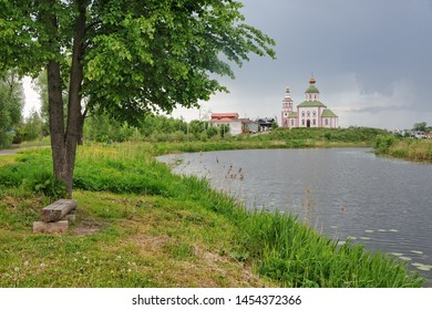 SUZDAL, RUSSIA - Kamenka River and the Church of Elijah the Prophet Framed by Tree.