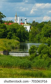 Suzdal, Russia. The lower dam on the river Kamenka and Suzdal domes of churches and bell towers.