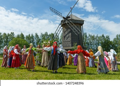 Suzdal, Russia - May 27, 2018: Folk festivities dedicated to the feast of the Holy Trinity in Suzdal. Girls in traditional sundresses lead dance.