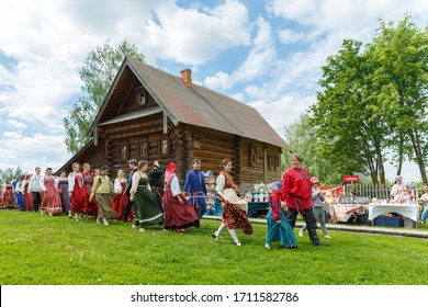 Suzdal, Russia - May 27, 2018: Folk festivities dedicated to the feast of the Holy Trinity in Suzdal. People in traditional Russian costumes walk along the village.