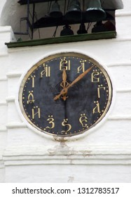 Suzdal, Russia - October 15, 2012: Unusual and original old clock on Cathedral bell-tower of famous Suzdal Kremlin. Site from UNESCO world heritage list. Letters instead of numbers.