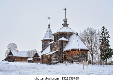 SUZDAL, RUSSIA - Resurrection Church and Peasant Houses Covered Snow the Museum of Wooden Architecture in Winter.