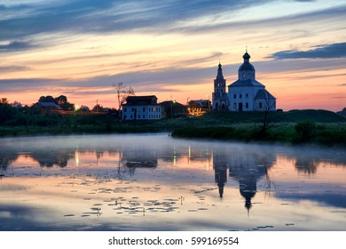 SUZDAL, RUSSIA - Sunset over Kamenka River. Beautiful night scenery of Suzdal during sunset with view from Pushkarskaya street on Kamenka river with reflections of a church of Elijah (Ilya) Prophet.