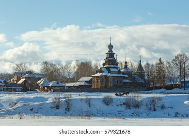 Suzdal, Russia. Typical Russian winter landscape with a horse drawn sleigh next to the wooden churches.
