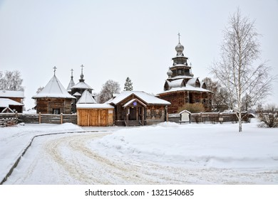 SUZDAL, RUSSIA - View from Pushkarskaya street on beautiful wooden churches and entrance into the Museum of Wooden Architecture framed by a birch tree in winter.