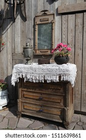 SUZDAL, RUSSIAN FEDERATION - SEPTEMBER 7, 2019: Old russian furniture (dresser). Ancient iron, antiquarian mirror, vintage silver samovar for tea drinking. Russian style in retro interior decor