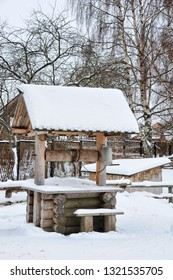 SUZDAL, VLADIMIR REGION, RUSSIA - Covered snow reconstructed log well-winch with roof on the grounds of the Suzdal's Museum of Wooden Architecture and Peasant's Life in winter season.