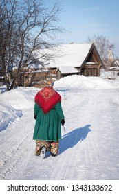 SUZDAL, VLADIMIR REGION/RUSSIA - FEBRUARY 13, 2019: Woman in traditional russian dress walks down the street