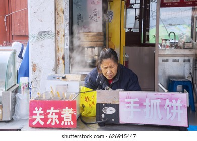 SUZHOU, China. April 21, 2017: Picture of female street vendor in Suzhou, China