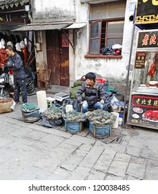 SUZHOU, CHINA - NOV 6: A trader at his hairy crab stall on November 6, 2012 in Shantangjie, Suzhou, China. Shantangjie is a 1100 year old historic market street build in 825 AD in the Tang Dynasty.