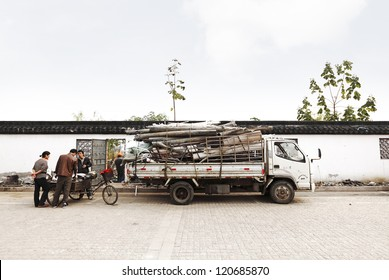 SUZHOU, CHINA - NOV 8: Scrap dealer with delivery truck on Nov 8, 2012 in Suzhou, China. Chinas steel exports accumulated to 22.04mln tonnes, up by 10.1% y-o-y, leading to boom in scrap metal trade.