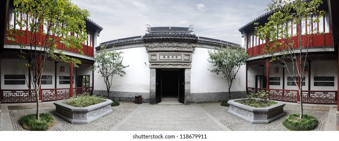 SUZHOU, CHINA - NOVEMBER 8: Panoramic facade of the traditional courtyard in the Couple's Garden Retreat on November 8, 2012 in Suzhou, China. The classical garden is  a UNESCO World Heritage site.