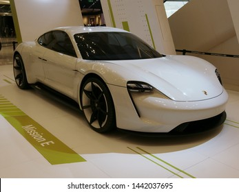 Suzhou, Jiangsu / China - 8 June 2019: Front-side view of an all electric white Porsche E-Mission concept car to be released late 2019 as the 'Taycan'