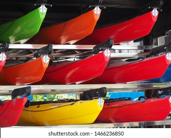 Suzhou, Jiangsu/ China - 9 June 2019: brightly colored canoes in racks ready for use forming an abstract pattern