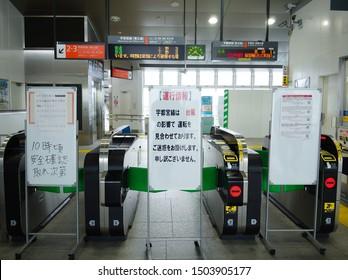 SUZUMENOMIYA, TOCHIGI / JAPAN – SEPTEMBER 9, 2019: The signboard announced that the Utsunomiya line train service was suspended due to the typhoon 15 passing over.