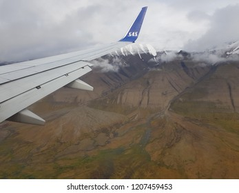 SVALBARD, LONGYEAR AUGUST 19 2018: sas airplane approaching svalbard with barren and beautiful svalbard nature background
