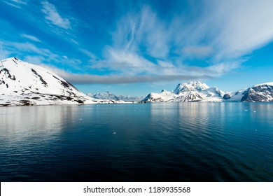 Svalbard, Norway, 06202018: Arctic Landscape in the beautiful island of Svalbard, with Ice and glacier touching the arctic ocean