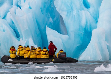 Svalbard, Norway, July 11th, 2013: people traveling in a zodiac in between glaciers of Svalbard