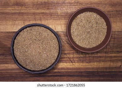 Svan salt - traditional Georgian flavoring in a clay bowls on a wooden background.