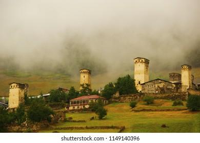 svaneti watchtowers. mountains and clouds at dawn. Svaneti region. Georgia