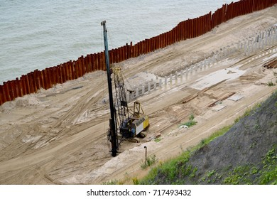 Svayeboyny installation on building of bank protection strengthening on the bank of the Baltic Sea