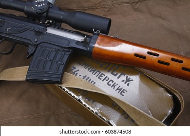 """SVD sniper rifle with box of ammunition on canvas background. The inscription translates as """"Snipers Ammunitions"""""""