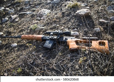 SVD sniper rifle lying on the ground in the woods