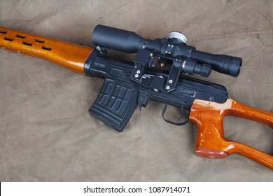 SVD sniper rifle on khaki canvas background