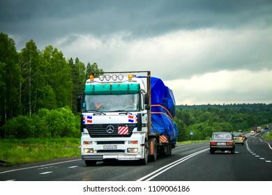 Sverdlovsk region, Russia - June 25, 2011: Semi-trailer truck Mercedes-Benz Actros 1843 at the interurban road.
