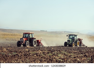 Sveti Nikole, Macedonia October 17, 2018: Two tractors ploughing a field near Sveti Nikole, Macedonia.
