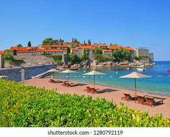 Sveti Stefan island and beach in sunny summer day, Budva, Montenegro