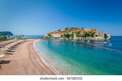 Sveti Stefan luxury touristic resort with historical village on the island and paradise Adriatic sea sand beach. Budva, Montenegro.
